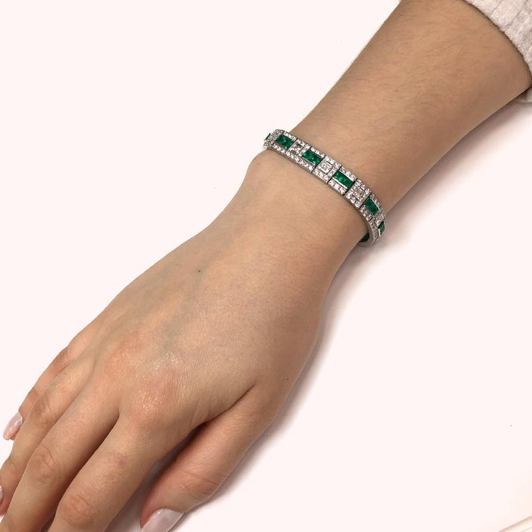 Art Deco retro inspired platinum 950 bracelet with princess cut Zambian emeralds 6.28 ct and round natural white diamonds 9.36 ct. Natural Diamonds G-H Color Clarity VS. A really gorgeous vintage slim bracelet that will get you noticed.