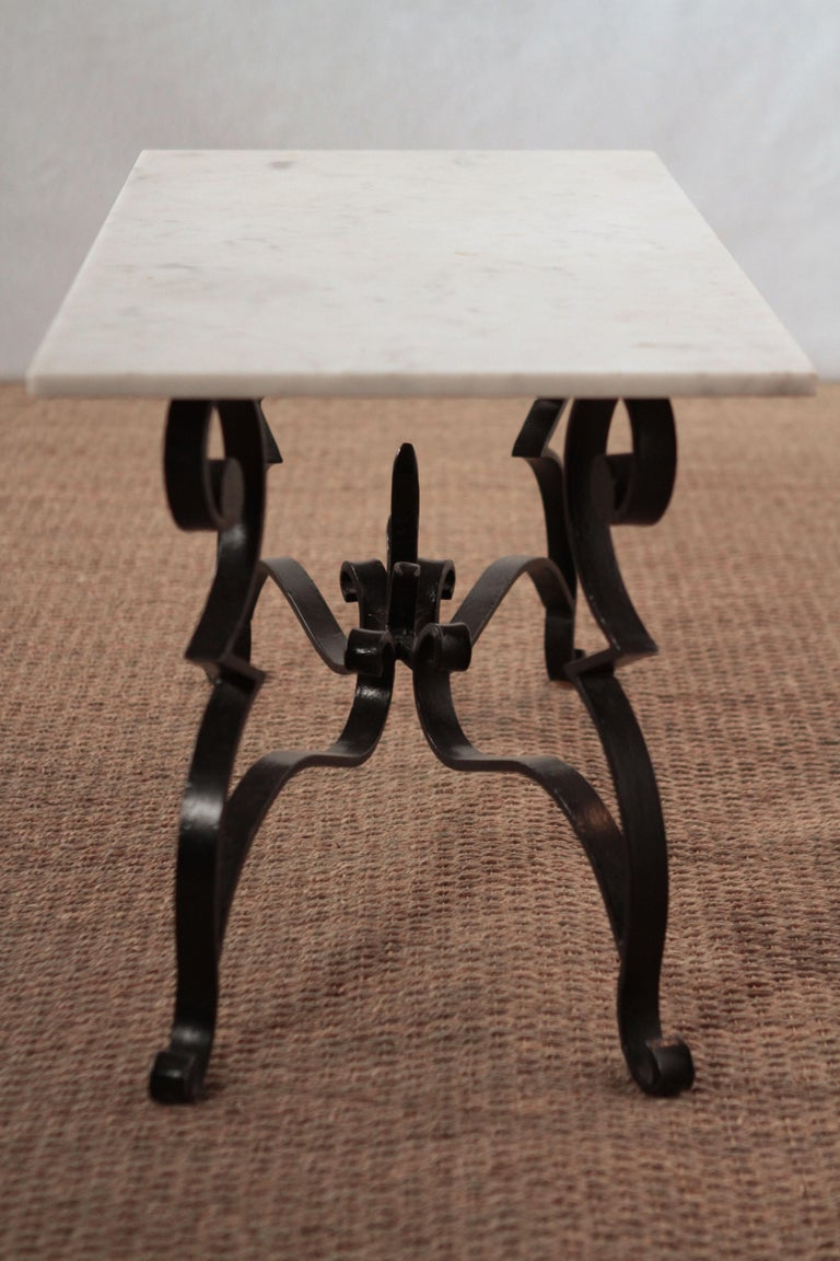 Wrought Iron Art Deco Iron Feet Marble Top Coffee Table Style of Raymond Subes, 1950s For Sale