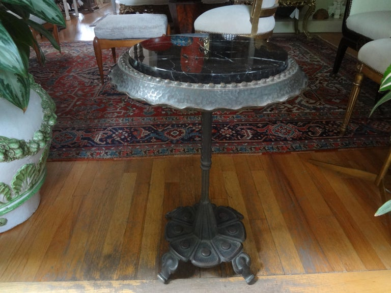 Fantastic stylized Art Deco iron table with a marble top. This stunning Addison Mizner style Art Deco pedestal table is the perfect side table, drinks table, guéridon or cigarette table. Our table would work in a variety of interiors.