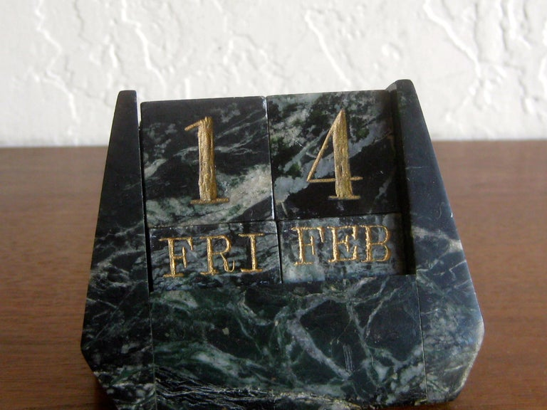 Outstanding Art Deco Italian green marble perpetual desk calendar. Carved out of natural green marble and features the day, date and month. Great color and form. In excellent shape with no cracks, no chips and no repairs. Measures: 3 1/2