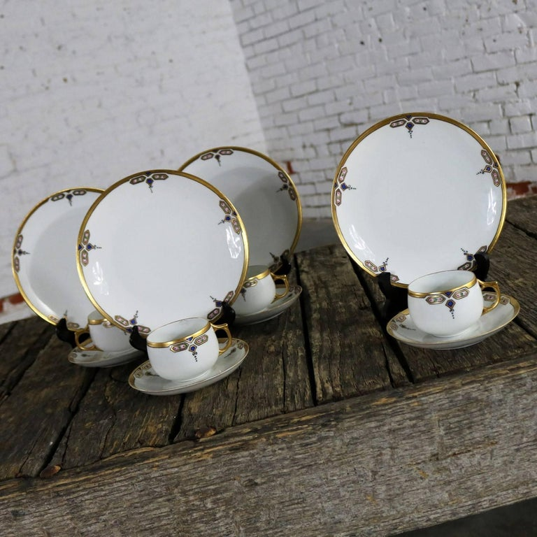 Delightful Art Deco luncheon set by J and C Bavaria aka Jaeger and Co. Comprised of four three-piece place settings consisting of luncheon plate, cup, and saucer. All are in fabulous vintage condition with no chips, cracks, or crazing. By its mark