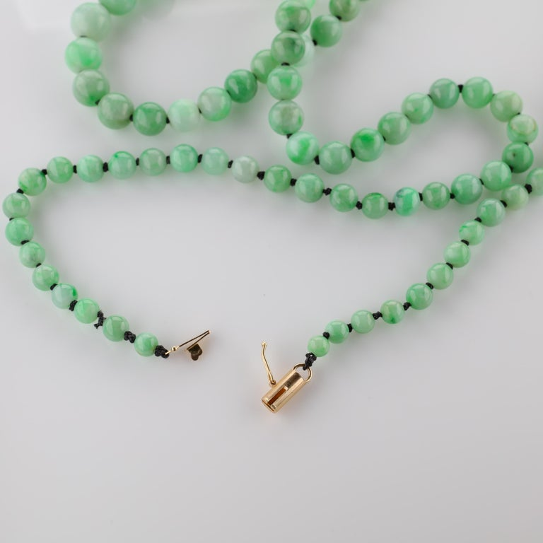 This 1930s-era certified natural and untreated jadeite jade necklace was purchased in England many years ago. The clasp could not be repaired so I located a clasp of similar design in 18K yellow gold and the necklace has been restrung on black silk,