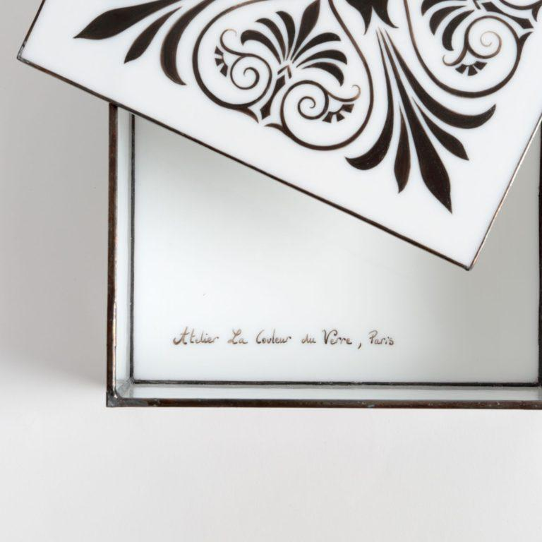 Exquisite hand painted glass jewelry box designed and handmade in France, using the Tiffany technique.   The artist starts with plates of hand blown glass in an opaque white that is particularly striking. Tiny air bubbles which appear in the