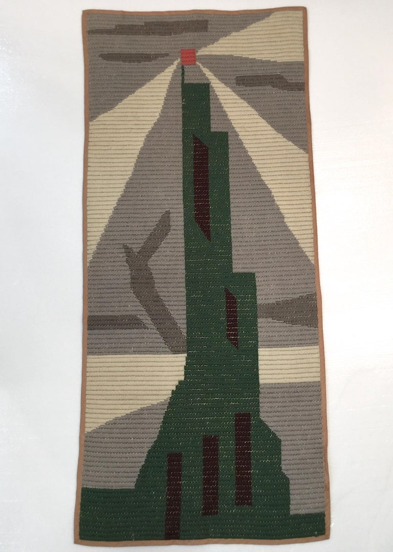 """Vintage knit tapestry 50"""" x 23"""" depicting a stylized Art Deco skyscraper. Futurist flair in the style of Fortunato Depero although probably American."""