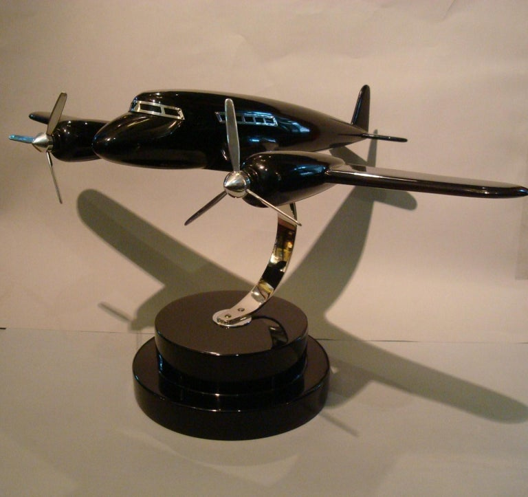 Art Deco lacquer wood airplane model, France, 1930s. Very nice and rare airplane model, made of lacquered wood and chrome windows and propellers.. Very good restored conditions.