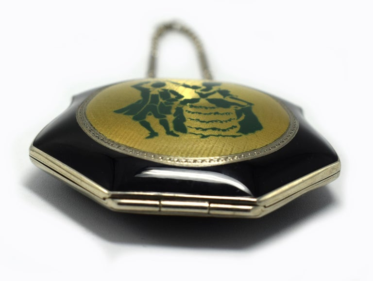 For your consideration is this highly styled Art Deco black enamel & guilloche compact depicting a period costume dancing couple. Dating to the 1930's this charming compact is in fabulous condition throughout with no damage to report, even the