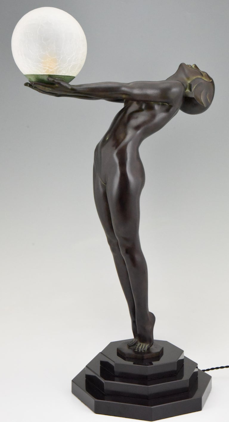 Patinated Art Deco Lamp Clarté Nude with Globe by Max Le Verrier For Sale