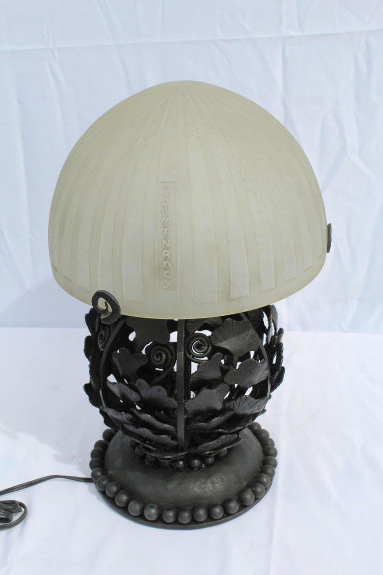 Art Deco Lamp made after the great E. Brandt and with a Daum style acid cut shade. Shade with name shown. All after the original. Excellent metal work of Ginko leaves. Heavy made.