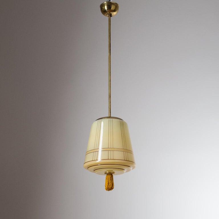 Very fine German Art Deco pendant/lantern, circa 1930. The elegant blown glass diffuser is enameled on the inside with a dark ivory color and has hand painted stripes on the outside as well as a finial tassel. Good condition with some patina on the