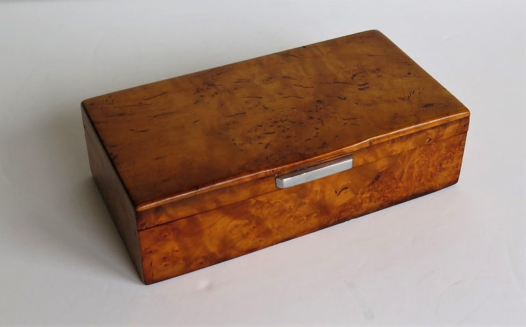This is a very good quality French Art Deco period Lidded Box, of Bird's Eye Maple with a chrome bar handle, dating to circa 1925. The box has a rectangular shape with bevel rounded edges to the top. The plan view of the top has been designed with a