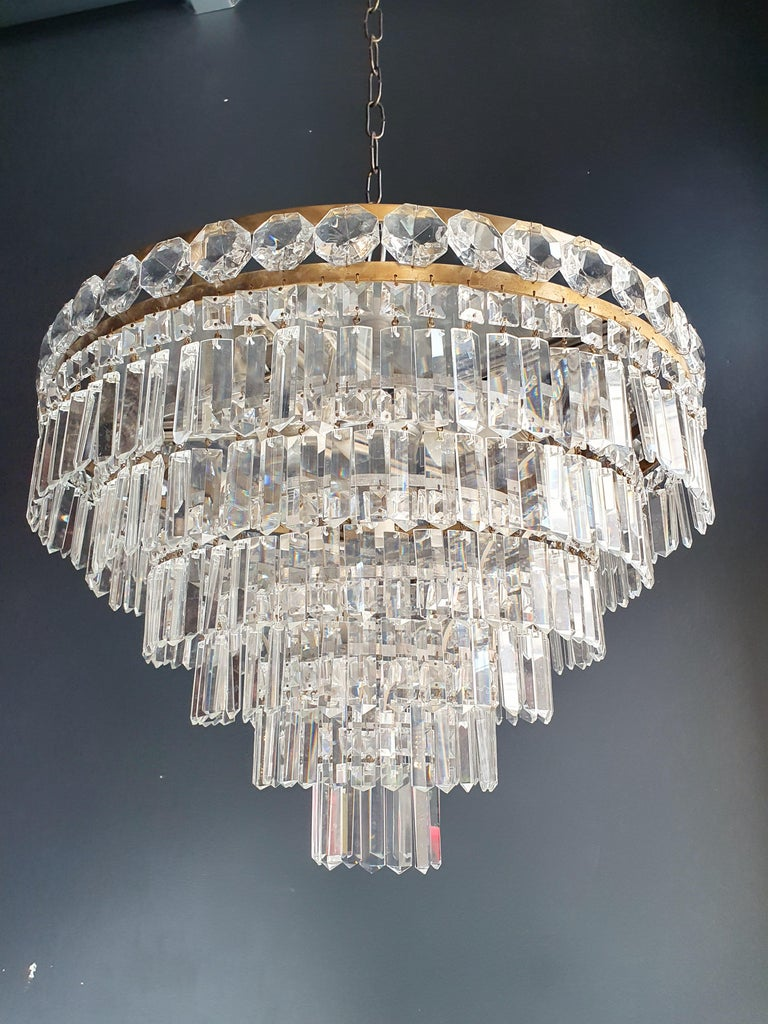 Low ceiling crystal chandelier brass. Cabling completely renewed. Crystal hand knotted. Measures: Total height 65cm, height without chain 43 cm, diameter 54 cm. weight (approximately) 8 kg.  Number of lights: 6-light bulb sockets: E27  Rewired