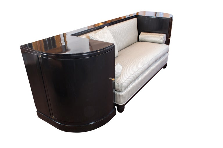 Beautiful unique original Art Deco sofa from the time, circa 1920. The sofa is black ebonized. The upholstery was renewed and newly upholstered with a beautiful Art Deco fabric from Vienna. The sofa is framed by two gondolas. The inside of the