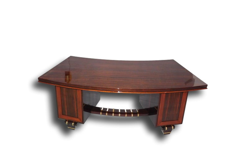French Art Deco macassar ebony double pedestal desk in the manner of legendary Art Deco Parisian furniture and interior designer, Émile-Jacques Ruhlmann. This very important and rare desk will be a focal point in any office with its geometric shape