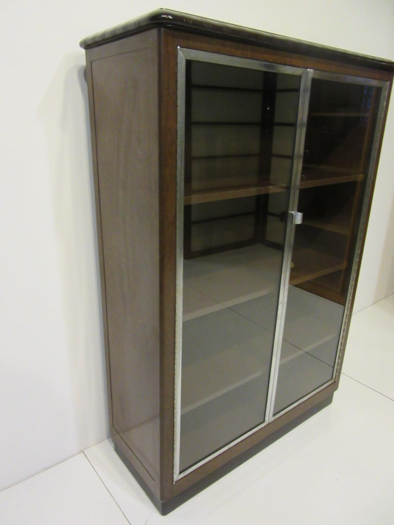 American Art Deco Machine Age Aluminum / Glass / Metal Bookcase in the Style of Deskey For Sale