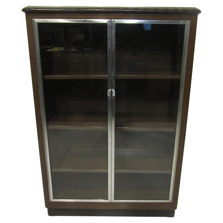 Art Deco Machine Age Aluminum / Glass / Metal Bookcase in the Style of Deskey For Sale
