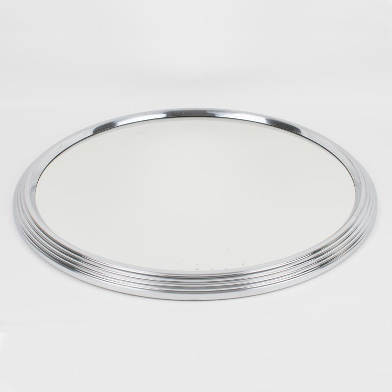 Oversized modernist French cocktail serving tray. Machine Age industrial design with chromed metal round stepped shape and mirror insert. Measurements: 16.94 in. diameter (43 cm) x 1.57 in. high (4 cm). (barware accessories not included in the
