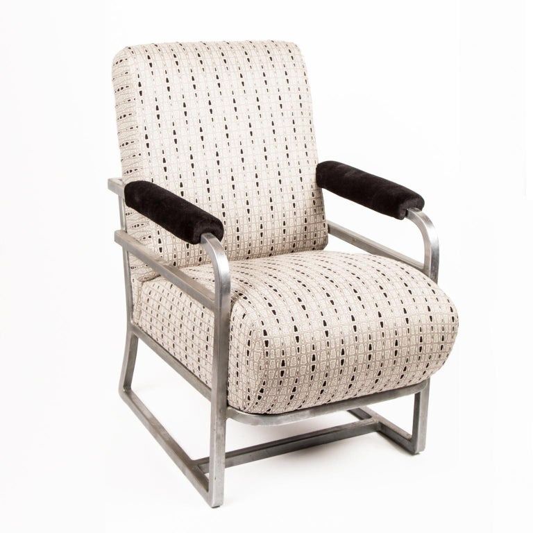 Art Deco machine age lounge chair or railroad chair after Raymond Loewy. New upholstery, circa 1940s.