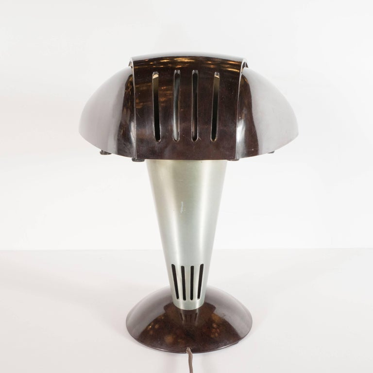 This graphic and iconic desk lamp was realized by the esteemed American designer Walter Dorwin Teague in America, circa 1939. It represents one of Teague's most important and celebrated designs. The lamp features a streamlined domed skyscraper style