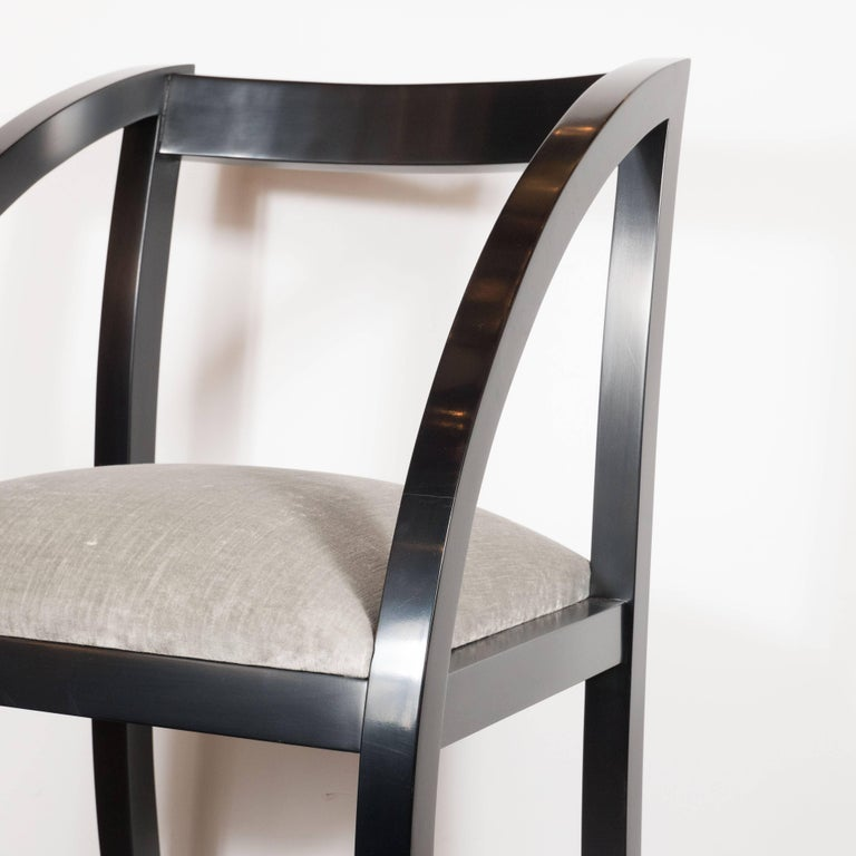 This elegant Art Deco side chair features gently arched black lacquer legs and a smoked platinum velvet seat. It is a stunning representation of the Machine Age's influence on Art Deco in America. An example of this chair was exhibited in the 1938