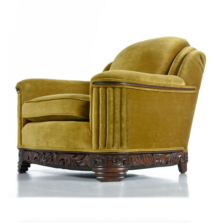 The soft and sensuous gold bronze mohair is in absolutely outstanding condition. Rippled waterfall style pleated tailoring is punctuated by the hand carved mahogany base and accents on the arms. One does not have to compromise comfort for style with