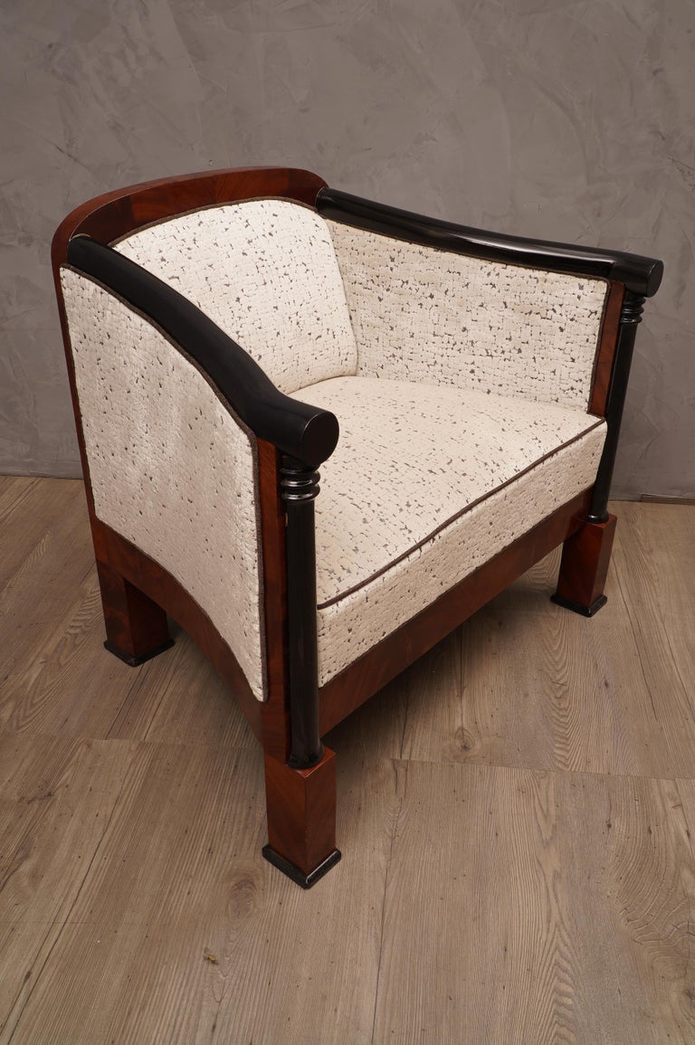 Superb armchairs in very fine mahogany wood, its design is also valuable, covered with a precious white velvet.  The armchairs has a wooden structure with mahogany veneer, the two armrests as you can see from the photos, are in black lacquered beech