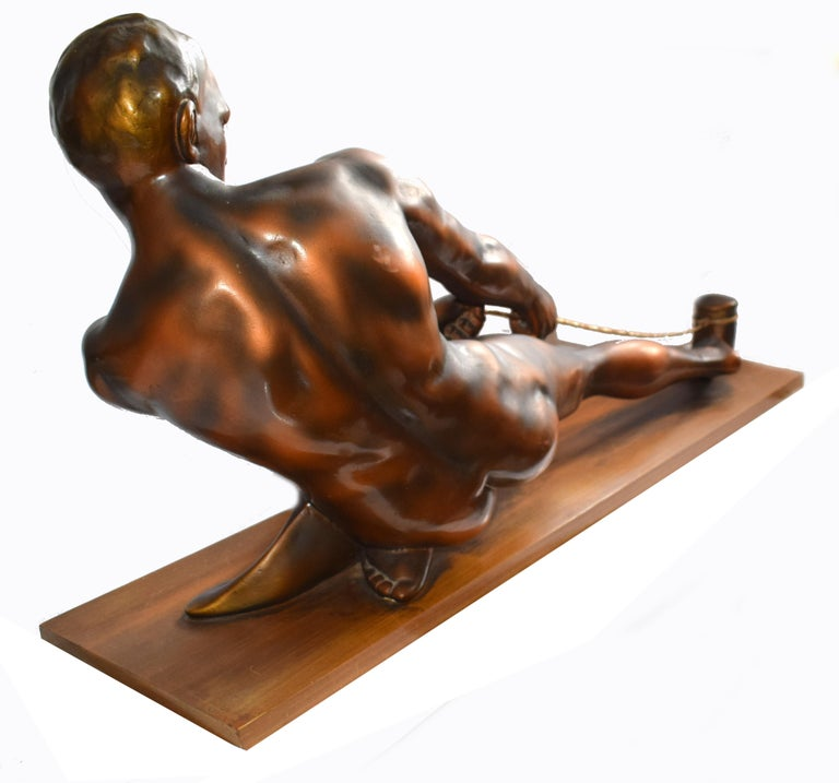 This is a stunning and impressively large (please see measurements below ) Art Deco male figure sculpted from plaster, it has a hard cast bronzed finish and is called 'The Rope Puller'. The detailing on this figure is of the highest quality