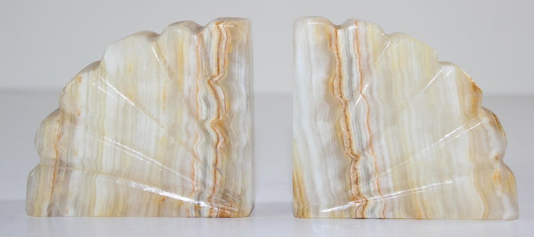 Hand carved marble book ends, These are very substantial, heavy and well handmade bookends. They are handmade creamy beige with auburn color.  Hand carved and polished with the side supports carved as a stylized scallop shell with curved upper