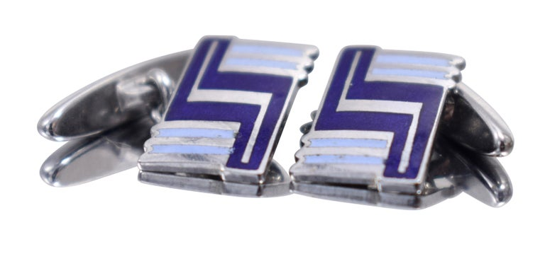 Fabulous pair of matching Art Deco men's cufflinks with a great geometric pattern. Silver toned metal with blue enamel decoration and dating to the 1930's. Condition is great with no wear at all. Ideal for the modern dapper gentleman.  All our