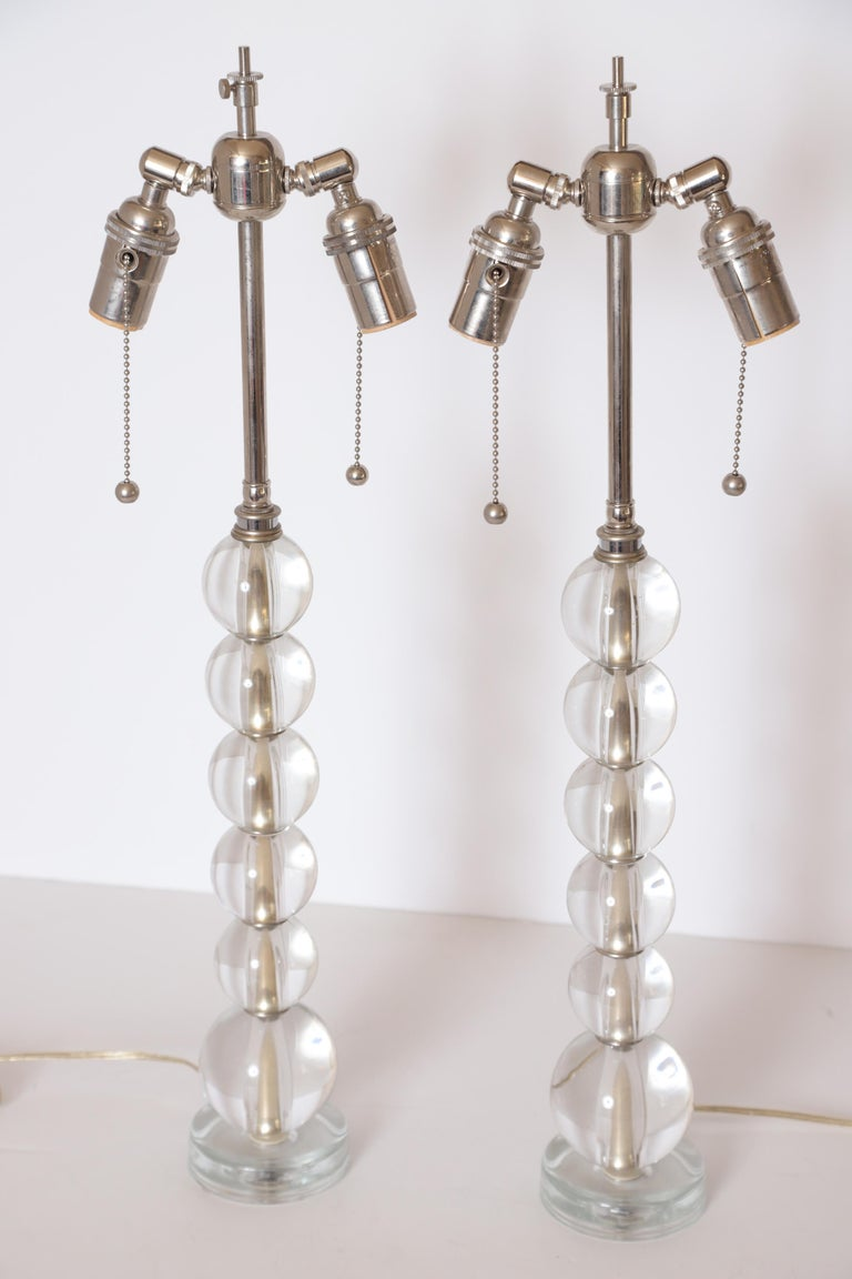 Art Deco Mid Century Pair Crystal Ball Table Lamps  Stylish pair Modernist 20th Century tall table lamps. These have either been completely restored or were a later production. Very good near-mint condition, very good chrome or nickel plate,