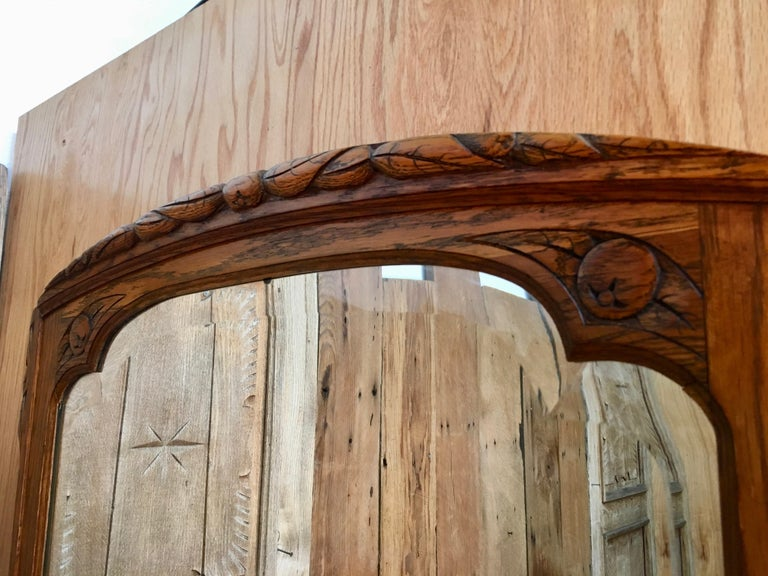 Beveled Art Deco Mirror with Carved Foliage For Sale