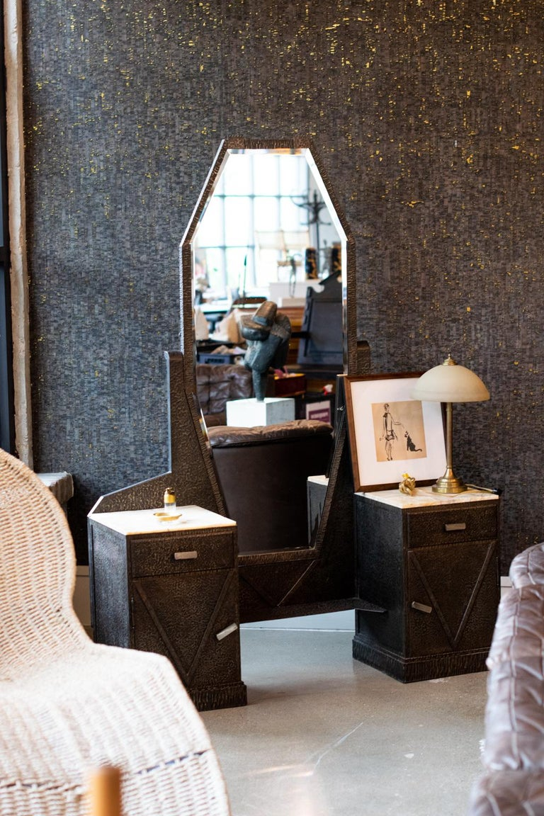 Art Deco dressing table with full length beveled mirror. Cabinets and frame are formed from steel that looks like bronze with onyx cabinet tops and original mirror. The hammered and finished steel is strongly reminiscent of work by Pier Luigi Colli