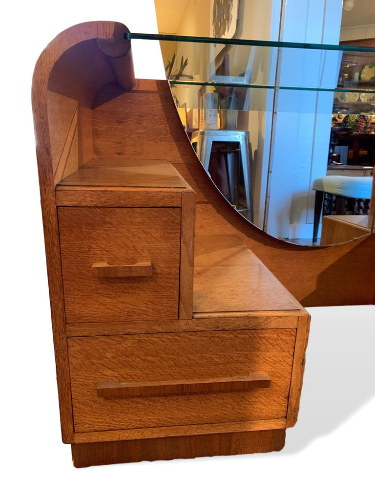 Art Deco golden oak mirrored vanity with drawers manufactured by English Company EG Furniture, 1940s. EG Furniture later became well known for their G-Plan Furniture range. Dresser/Vanity has four storage drawers with the top right having a small