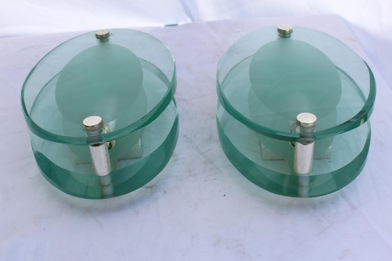A good looking cut and double beveled glass sconces. Hardware is silver plated. Has a single candelabra socket'? Cut 3/4