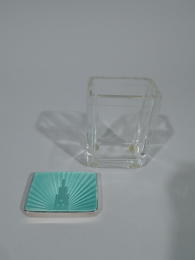 George V clear glass jar with sterling silver and enamel cover. Made by Henry Clifford Davis in Birmingham in 1933. Box is rectangular. Cover has green guilloche enamel top with skyscraper radiating shaded lines. The cover sides are silver. Smart