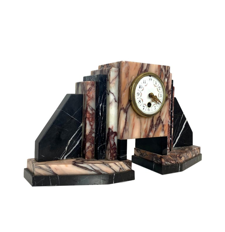 Art Deco moderne marble bookends mantle clock, with stepped and graduated marble books and bookends, French, circa 1930s.