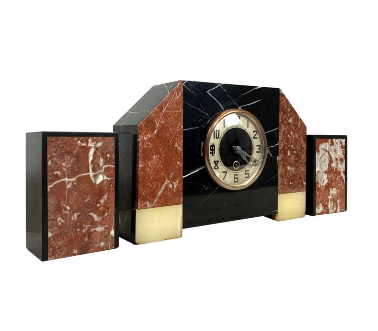 Art Deco moderne three-piece marble clock set, French, circa 1930s.