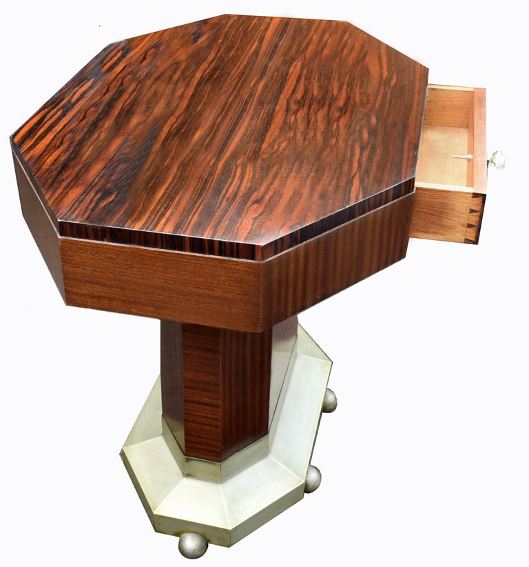 For your consideration is this wonderfully stylish modernist center table is the luxury woods of ebony Macassar which dates to the 1930s. There is a central drawer which is connected either side adding more functionality than just your regular