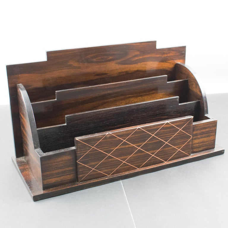 Elegant Art Deco modernist desk accessory, letter holder. Geometric shape mail rack, with Macassar wood veneer main body and copper metal lattice pattern accents. No visible maker's mark.  Measurements: 14.19 in. wide (36 cm) x 5.94 in. deep (15