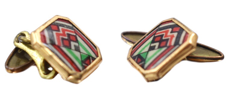 A rare find are these extremely stylish matching pair of English 1930's Art Deco modernist enamel gents cufflinks. Fabulous geometric patterning and colour, such a distinctive look. Condition is very good with only signs of age to the under link