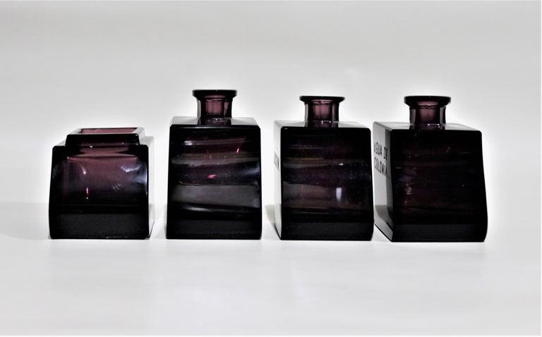 Czech Art Deco Moser Style Interlocking Amethyst Crystal Perfume Bottles and Jar Set For Sale