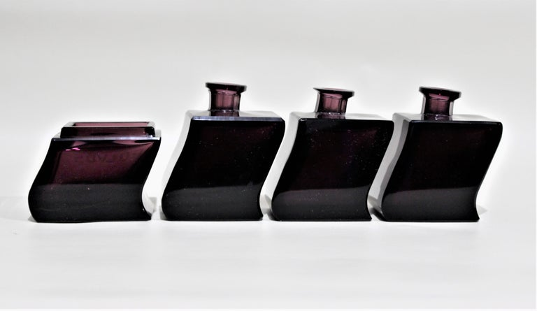 Hand-Crafted Art Deco Moser Style Interlocking Amethyst Crystal Perfume Bottles and Jar Set For Sale