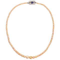 Art Deco Natural Pink Pearl Necklace with Diamond and Sapphire Clasp, circa 1930