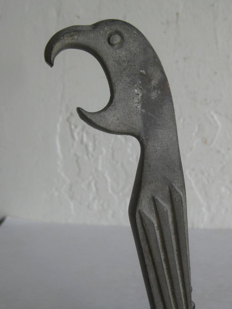 Great Art Deco figural parrot bird bar corkscrew bottle opener made by Negbaur and designed by Manuel Avillar, circa 1929. Appears it is made of bronze and has a silver painted finish. Some edge wear to the paint and is showing a bronze metal color.