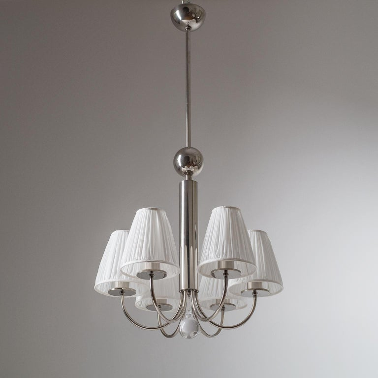 Rare six-arm Art Deco chandelier, circa 1928, with nickeled brass hardware and a large glass