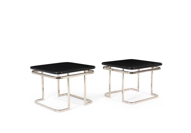 Beautiful Art Deco end tables Nickel frames with black lacquer tops.