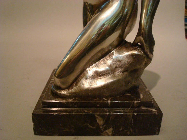 Art Deco figure of a nude woman. Made of bronze. Erotic sculpture. Very nice midcentury table item. Mounted over a marble base. Very good conditions. Signed J. Garnier.