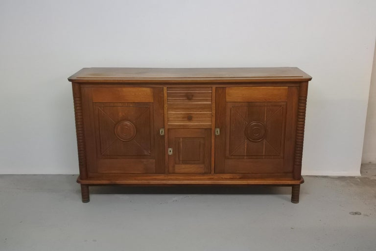 Art Deco sideboard in solid oak by Charles Dudouyt.