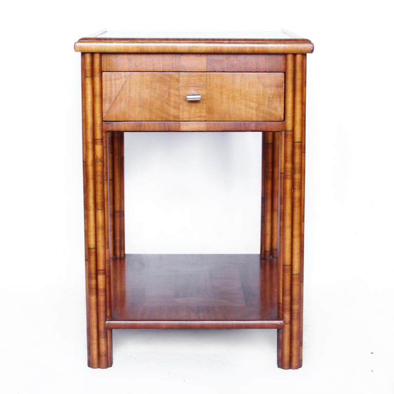 An Art Deco occasional table in walnut with veneered, reeded legs. Integral drawer and sliding tray. Original metal handle.  Dimensions: H 66cm, W 62cm, D 46cm  Origin: English  Date: circa 1930  Item no: 070120.