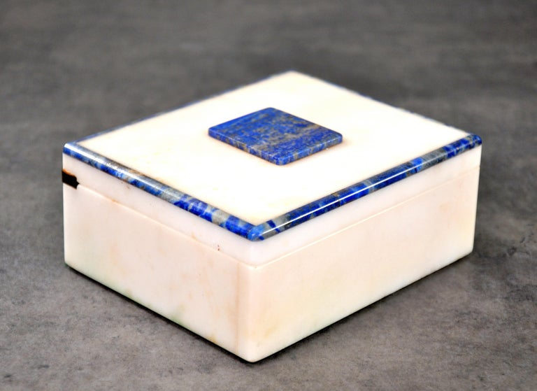 An Art Deco rectangular white onyx and lapis lazuli trinket, jewelry or vanity box with brass piano hinged lid.