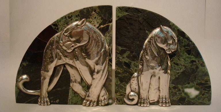 Art Deco pair of panther bookends. Silvered bronze and marble. Made in France, 1920s. Both stamped France. Heavy green and white marble bookends.